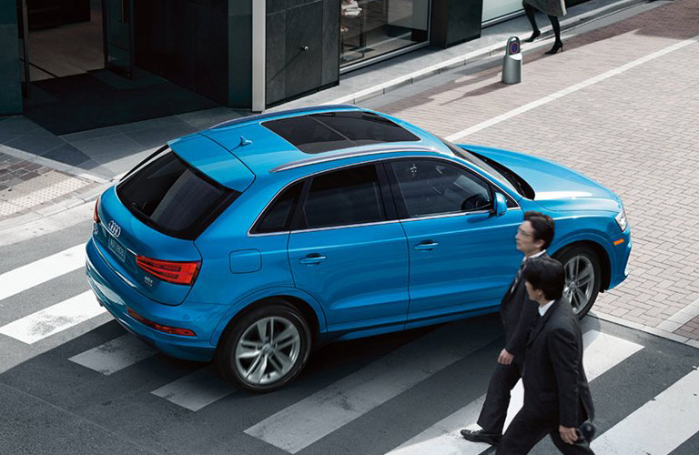 2016 Audi Q3 turning on a city street almost hitting people in the crosswalk