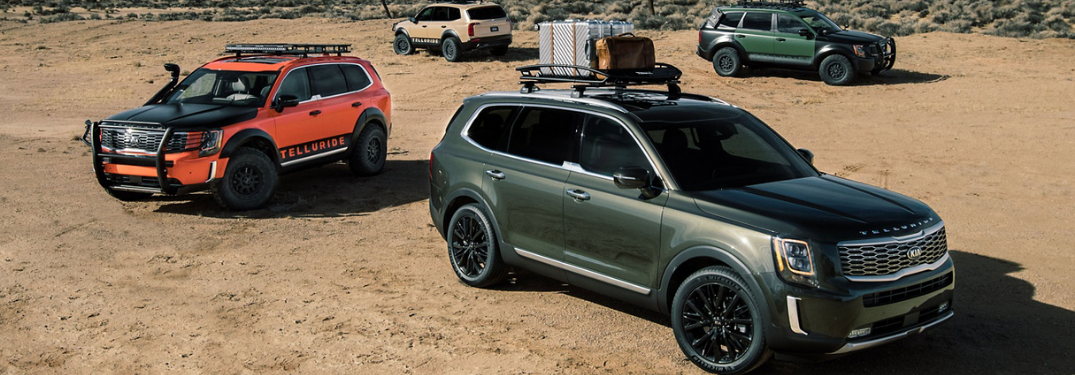 Three 2020 Kia Telluride parked outside in sand