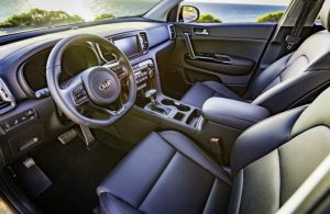 2018 kia sportage front row with steering wheel and infotainment system