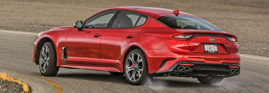 2018 kia stinger in hichroma red driving on a track