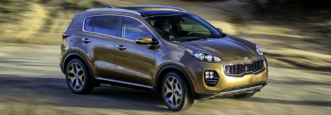 2018 kia sportage in burnished copper driving