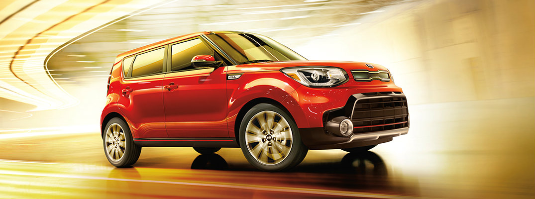 Profile view of red 2018 Kia Soul driving through tunnel