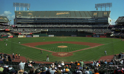Oakland County Coliseum hosting an Athletics baseball game