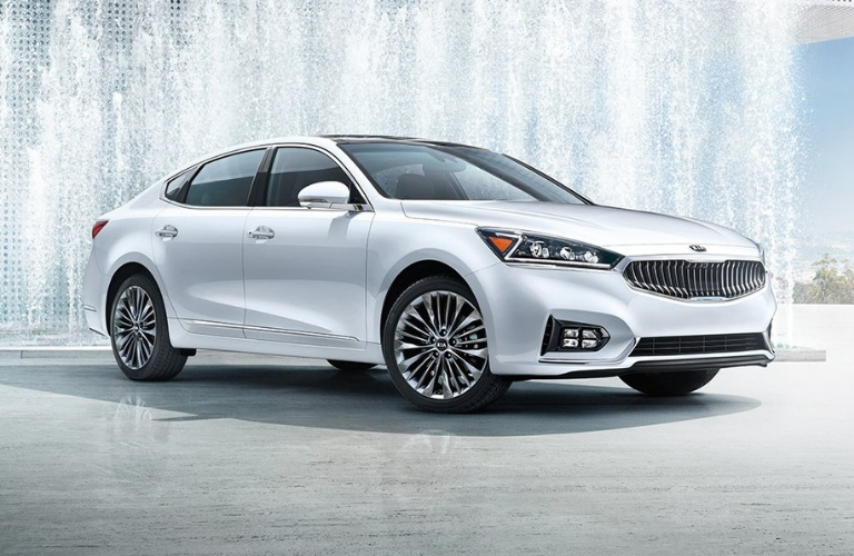 Exterior view of a silver 2019 Kia Cadenza parked near a water fountain