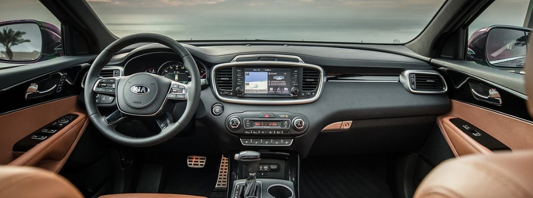 Interior view of the steering wheel and touchscreen inside a 2019 Kia Sorento