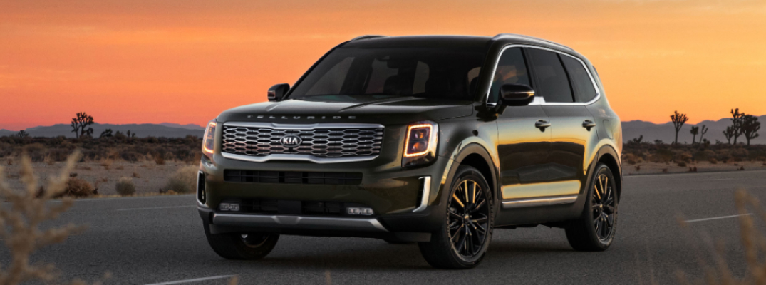 Dark grey 2020 Kia Telluride parked on a desert highway