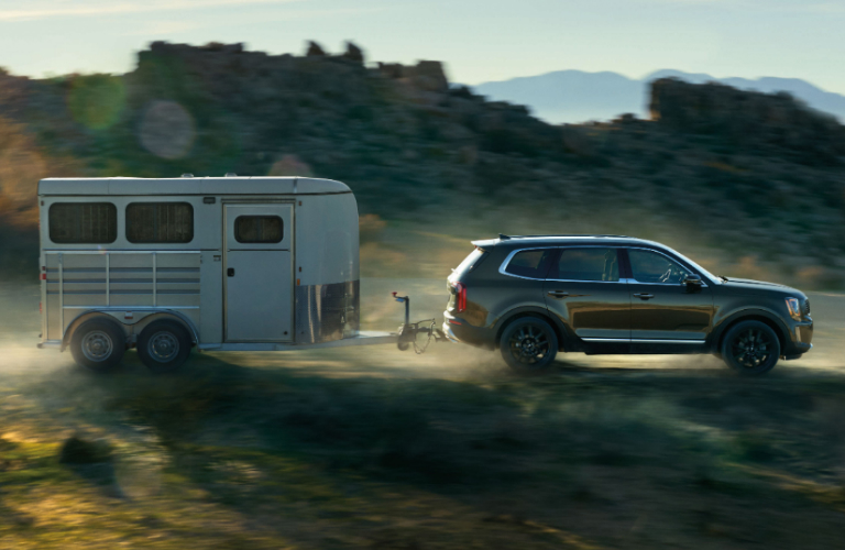 Dark grey 2020 Kia Telluride towing a trailer