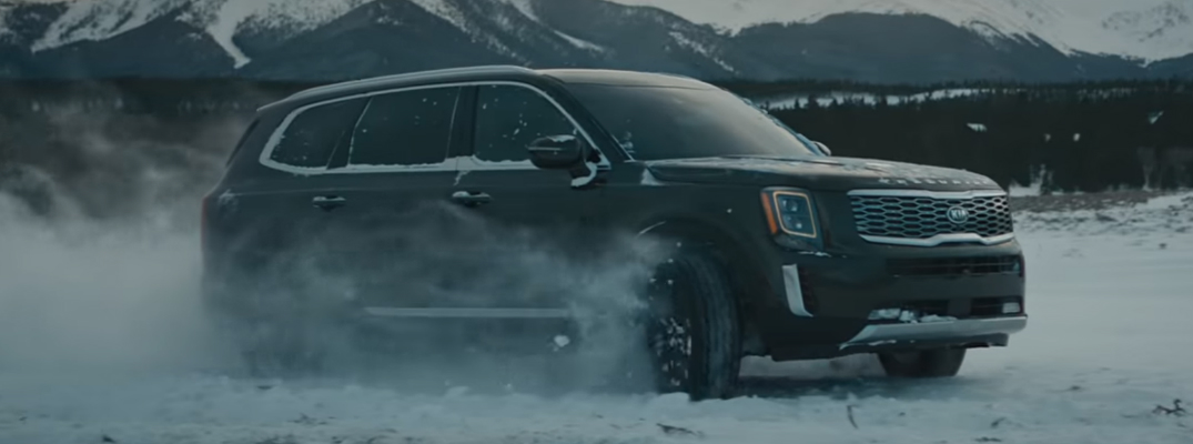 Grey 2020 Kia Telluride driving on snowy terrain
