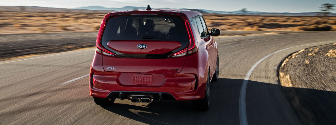 Red 2020 Kia Soul driving on a curvy road