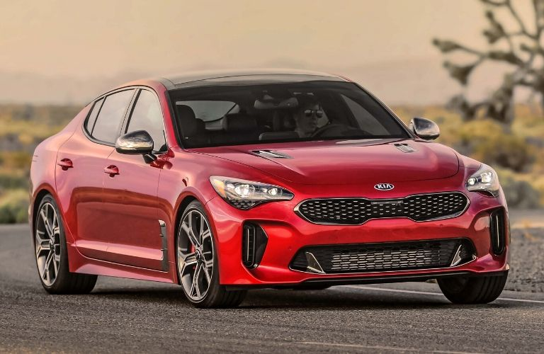 2020 Kia Stinger seen from the front rounding a curve