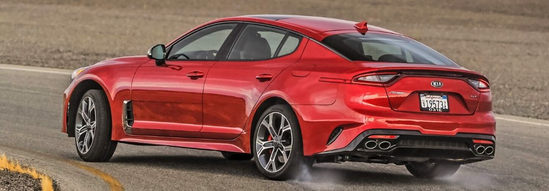 2020 Kia Stinger rounding a curve seen from behind