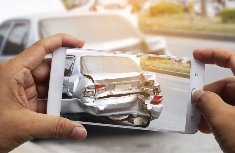 taking a photo of a car accident on a smartphone