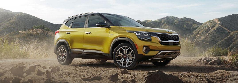 2021 Kia Seltos parked on a rocky road