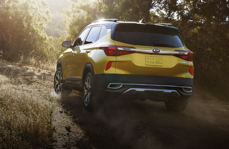 rear view of the 2021 Kia Seltos driving on rocky road