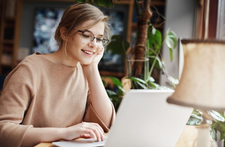 woman wearing glasses shopping on computer