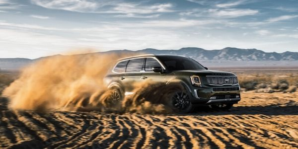 Green 2020 Kia Telluride Driving in Sand