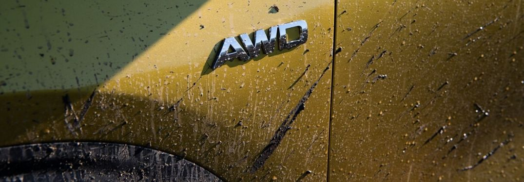 Close Up of AWD Badge on Yellow 2021 Kia Seltos