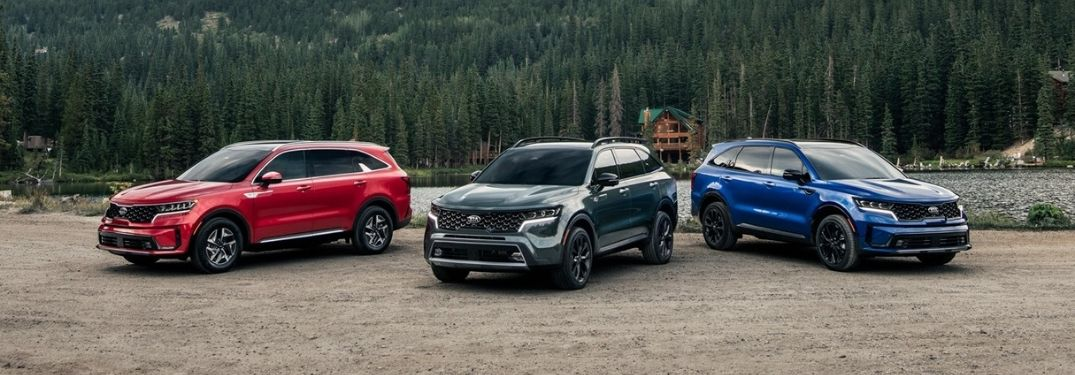 Red, Green and Blue 2021 Kia Sorento Models Next to a Lake