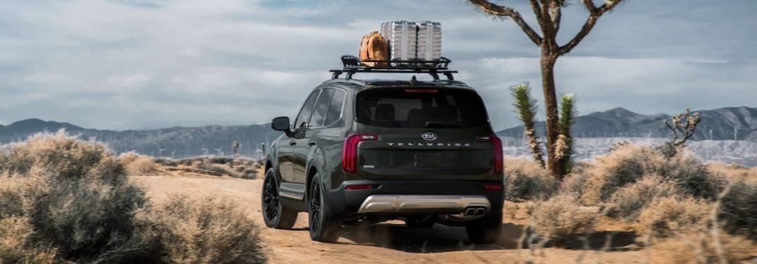 Green 2021 Kia Telluride on a Trail with Rooftop Luggage Carrier