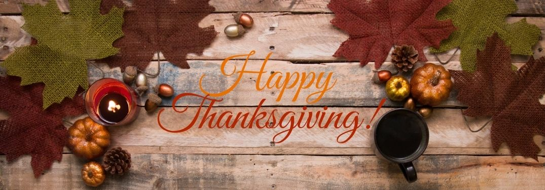 Fall Decor on Wood Background with Orange and Red Happy Thanksgiving Text