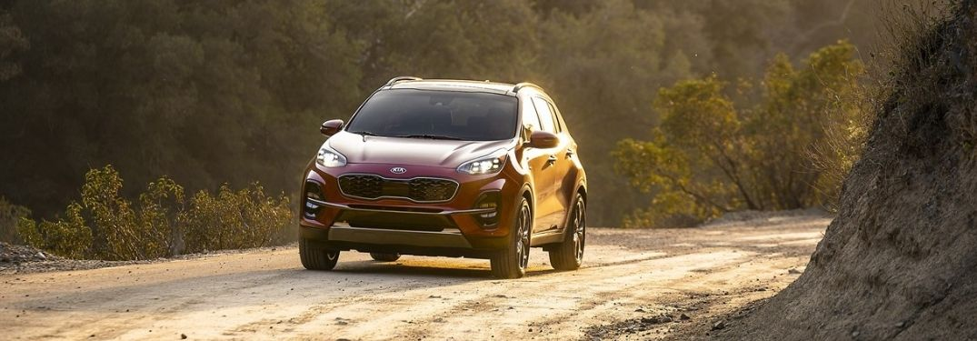 Red 2021 Kia Sportage on Dirt Road