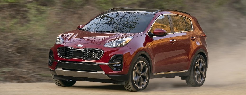 2021 Kia Sportage driving down dirt road