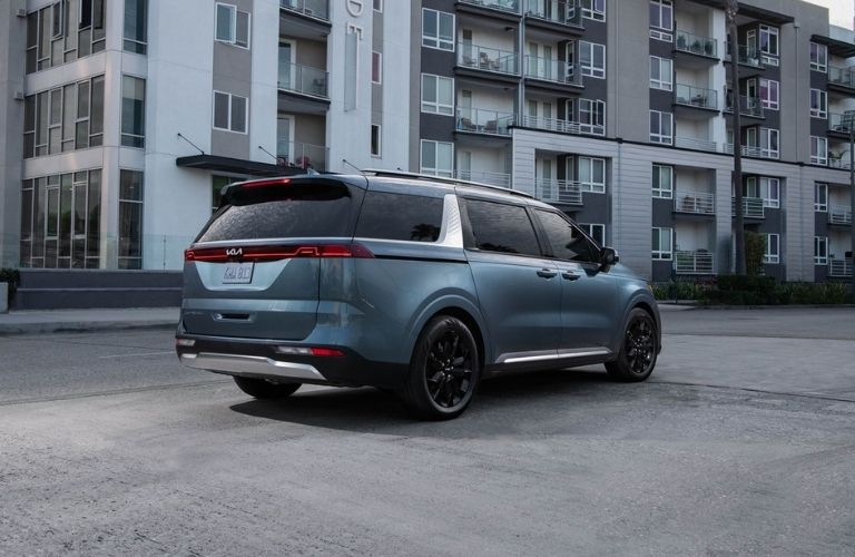 Blue 2022 Kia Carnival Rear Exterior in a Parking Lot