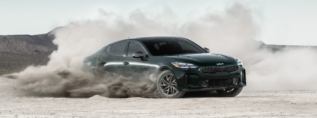A photo of the 2022 Kia Stinger kicking up dust.