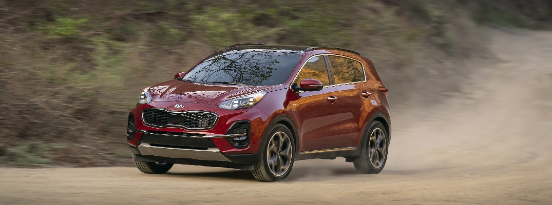 A photo of the 2022 Kia Sportage on a dusty trail.