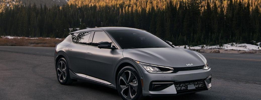 2022 Kia EV6 on the road with mountain backdrop