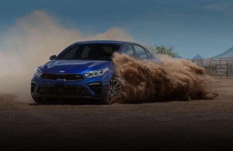 Kia Forte on a sandy terrain