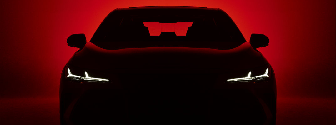 Silhouette of 2019 Toyota Avalon on red background with headlights shining