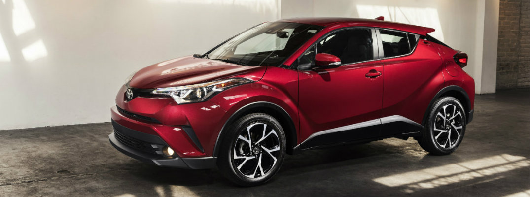 Profile view of red 2018 Toyota C-HR parked in building