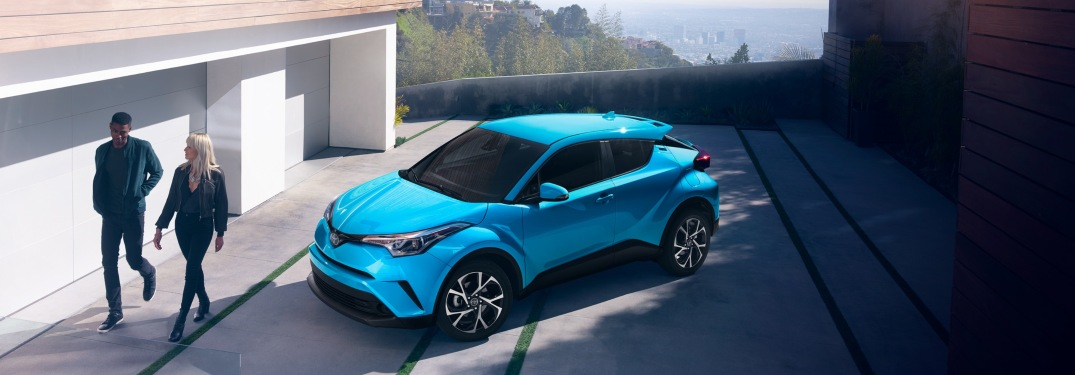 Couple walking away from a parked 2019 Toyota C-HR