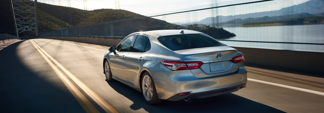 2019 Toyota Camry driving over a bridge
