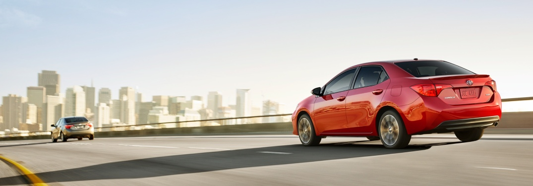 Two 2019 Toyota Corolla models driving into a city
