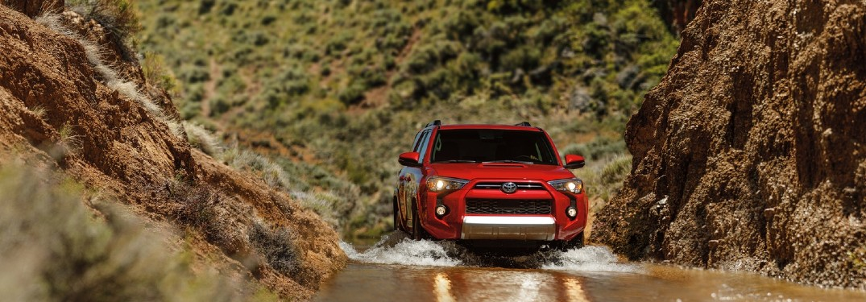 red 2020 Toyota 4Runner driving through water