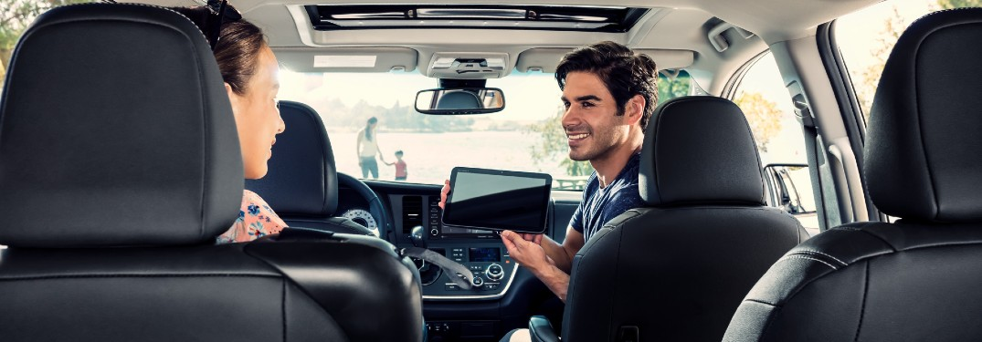 man using technology features inside the 2020 Toyota Sienna