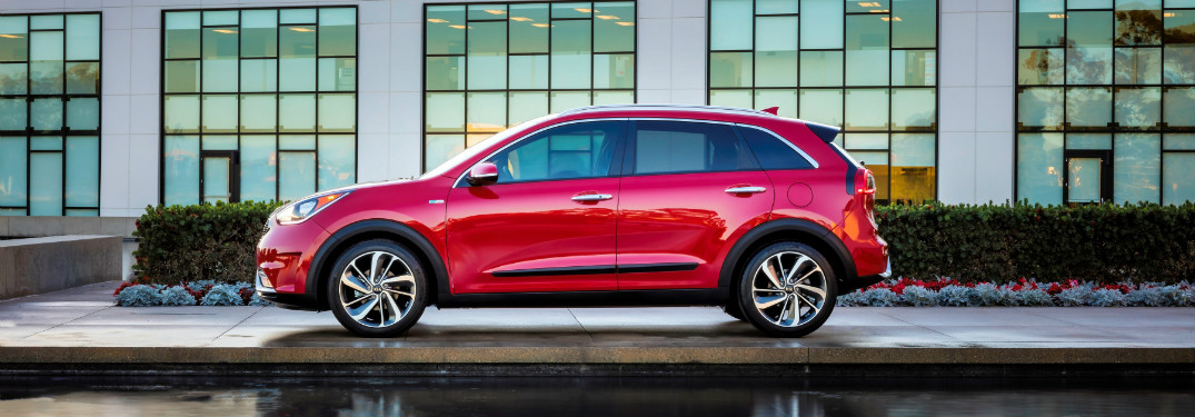 2018 Kia Niro parked outside building with many windows