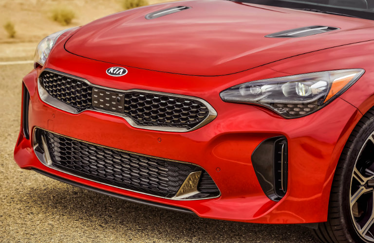closeup of grille of red kia stinger