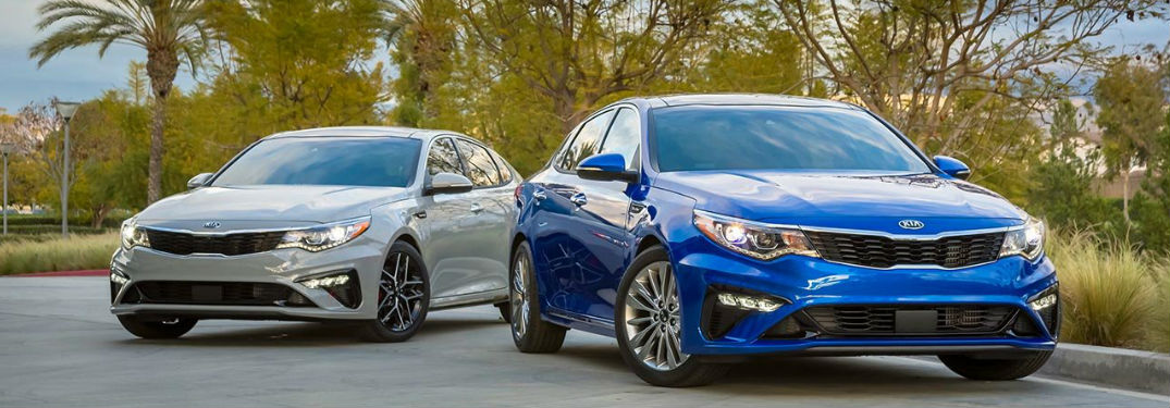 Two 2019 Kia Optima sedans parked next to each other