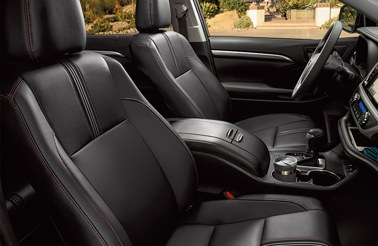 Front two seats and steering wheel of 2019 Toyota Highlander