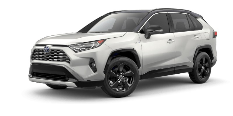 Front driver angle of the 2019 Toyota RAV4 in Blizzard Pearl/Midnight Black Metallic Roof color