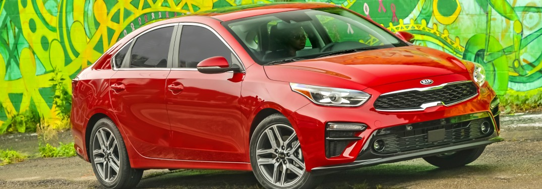 2019 Kia Forte red side view with green background