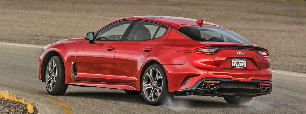 A left profile photo of the 2019 Kia Stinger going around a race track.