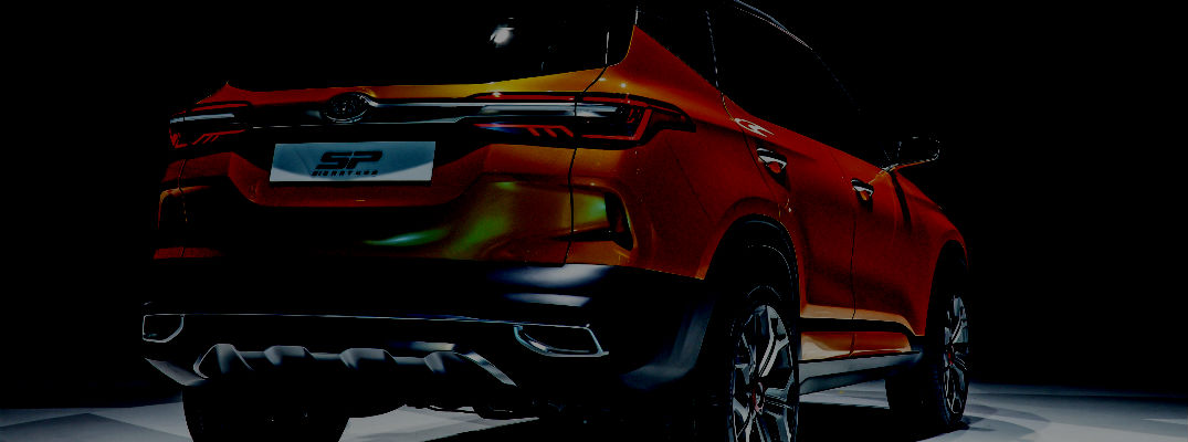 A silhouetted photo of a new Kia concept crossover SUV.