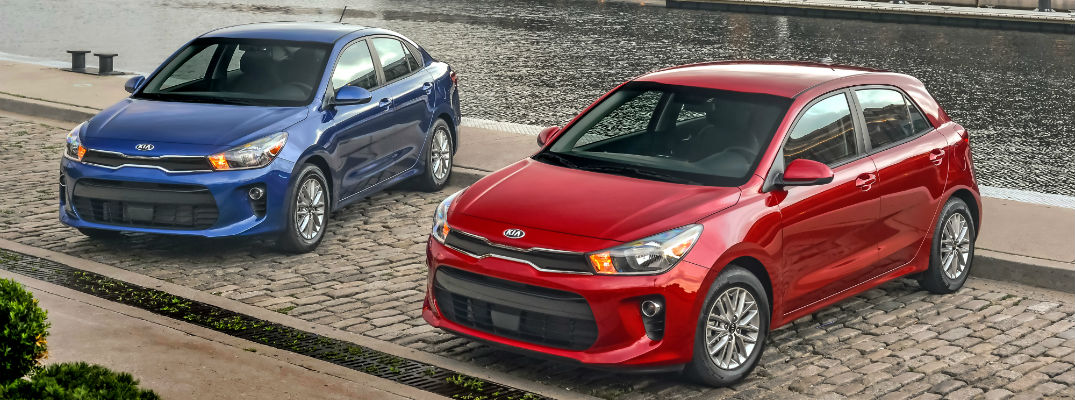 A photo of the 2020 Kia Rio models parked by a river.