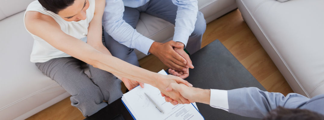 A stock photo of the people shaking hands after completing a deal.