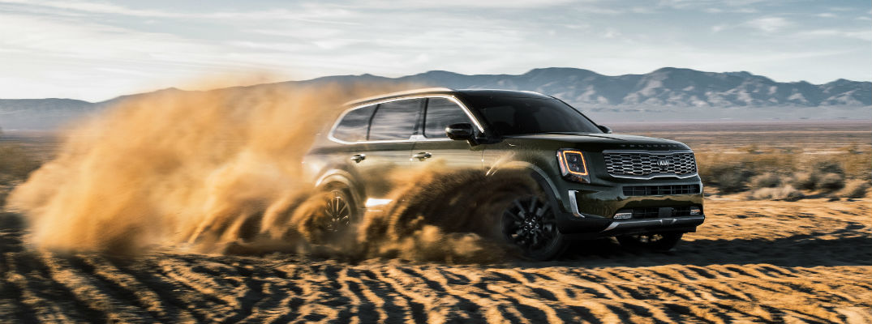 A right profile photo of the 2020 Kia Telluride driving through the desert.