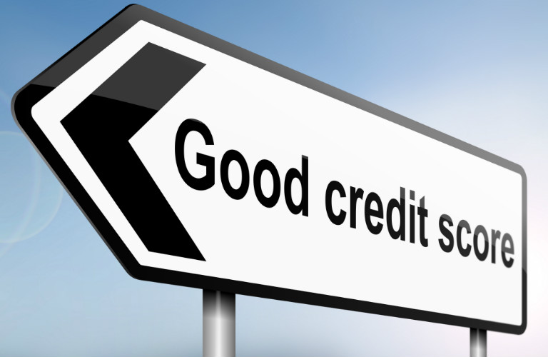 Black and white sign with an arrow on it and text that reads good credit score